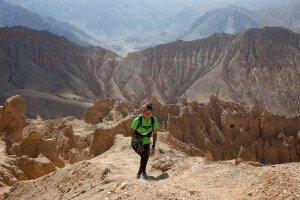 Tashi Sherpa running above Konchok Ling, Upper Mustang, Nepal